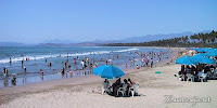 Mexican families enjoying the beach Playa Linda