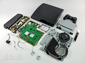 playstation 3 slim taken apart with all the bits laid out
