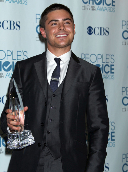 zac efron 2011 photoshoot. Zac Efron shows off his award