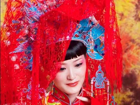 Before her wedding celebration a chinese bride traditionally goes into