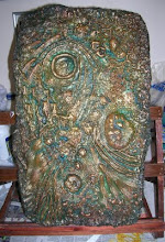 Plaster cast painted in layers, rubbing back into paint each time.