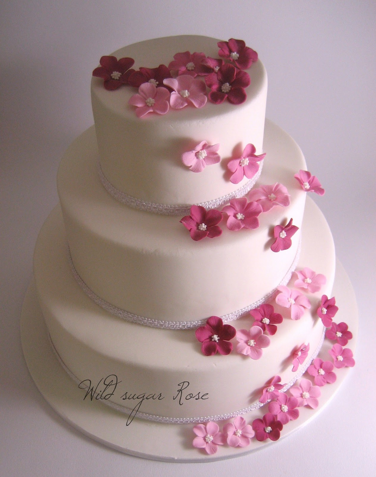Wild sugar Rose wedding cakes cupcakes and cake