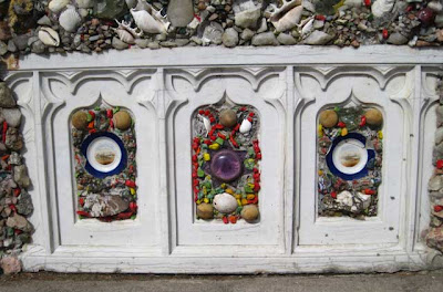 White wooden ecclesiastical panels with stones, glass and plates attached