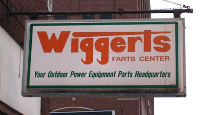 Wiggerts Parts Center sign. The right side of the P in Parts has been scratched off so it looks like an F
