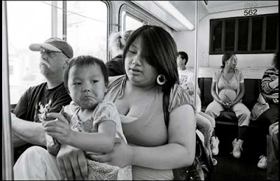 Young mom with baby on Metro Transit bus, black and white photo
