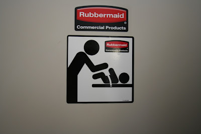 Classic international symbols. Baby's arms are raised as if to defend from the parent, bending over with arms raised also