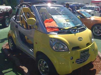 Yellow futuristic-looking mini car