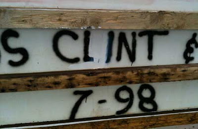 Close up of the name CLINT showing white paint over part of the letter L