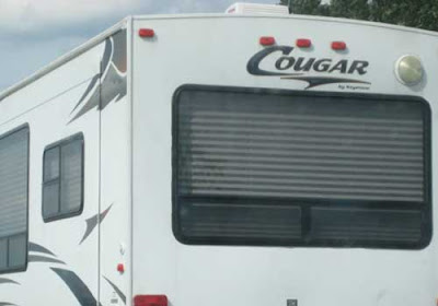 Back of an RV with large logo reading Cougar