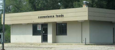 Beige rectangular building with small sign reading Convenience Foods