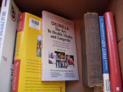 Book in a box, with cover reading Chlorella, etc.