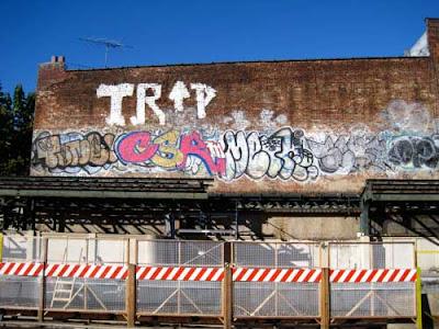 Graffiti on wall above construction