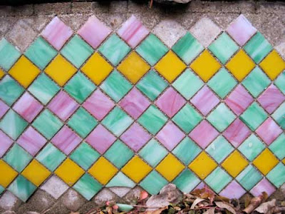 Orange, pink and green square tiles in a harlequin pattern