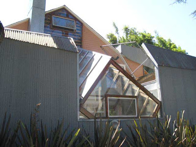 Wood and corrugated metal house with odd shaped window