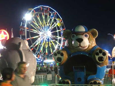 Giant metal bear, part of a kiddie ride