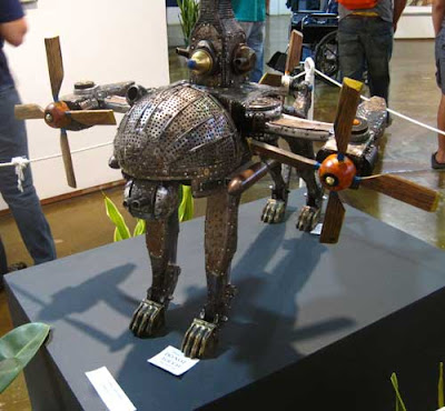 Metal and wood dog with head made of vegetable steamers