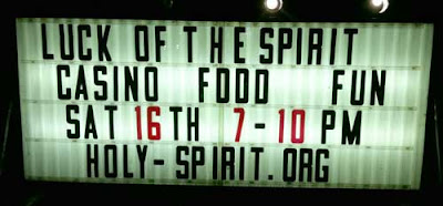 Lit temporary sign reading Luck of the Spirit - Casino - Food - Fun