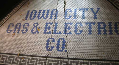 Iowa City Gas & Electric name in dime tile floor outside a door