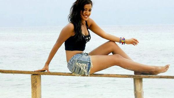 neha sharma on the beach in shorts unseen pics