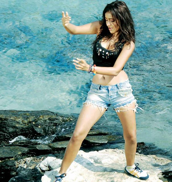 neha sharma on the beach in shorts