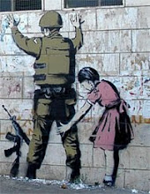 Palestinian girl frisking Israeli soldier--Grafiti on the terrorist wall dividing Israel/West Bank