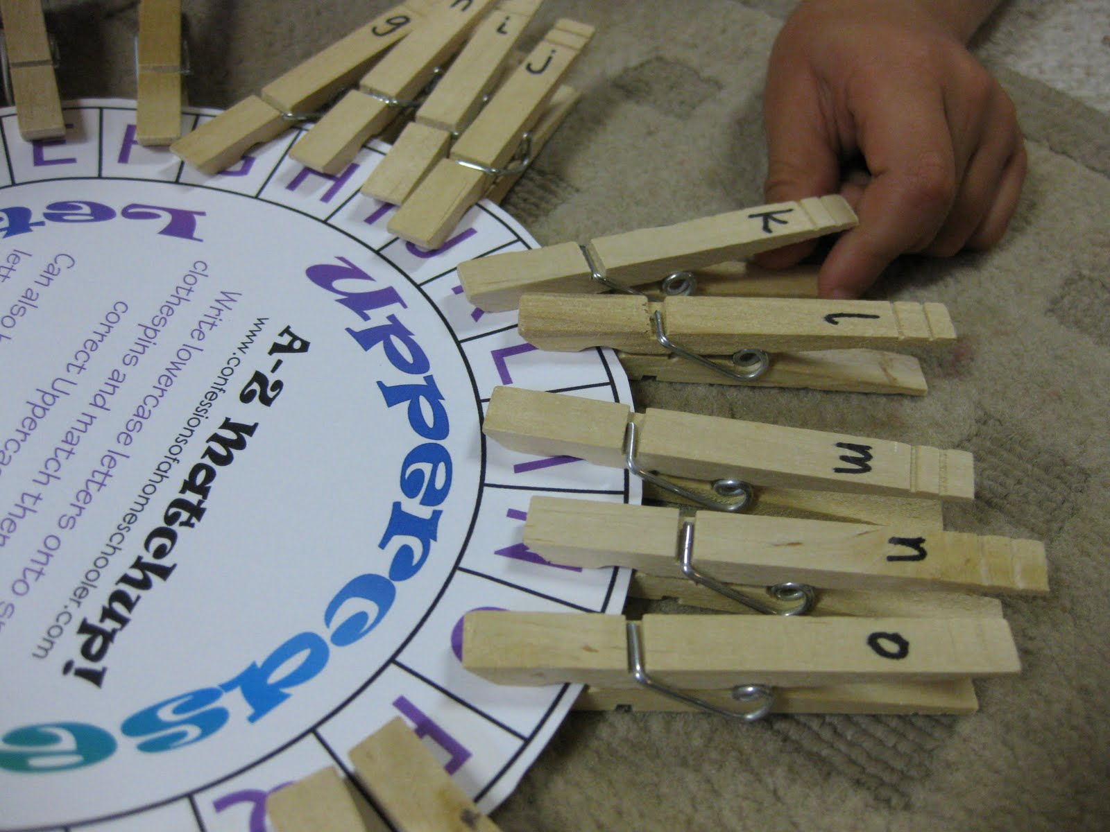 owen matches lowercase clothespins to uppercase letters on With clothespin letters
