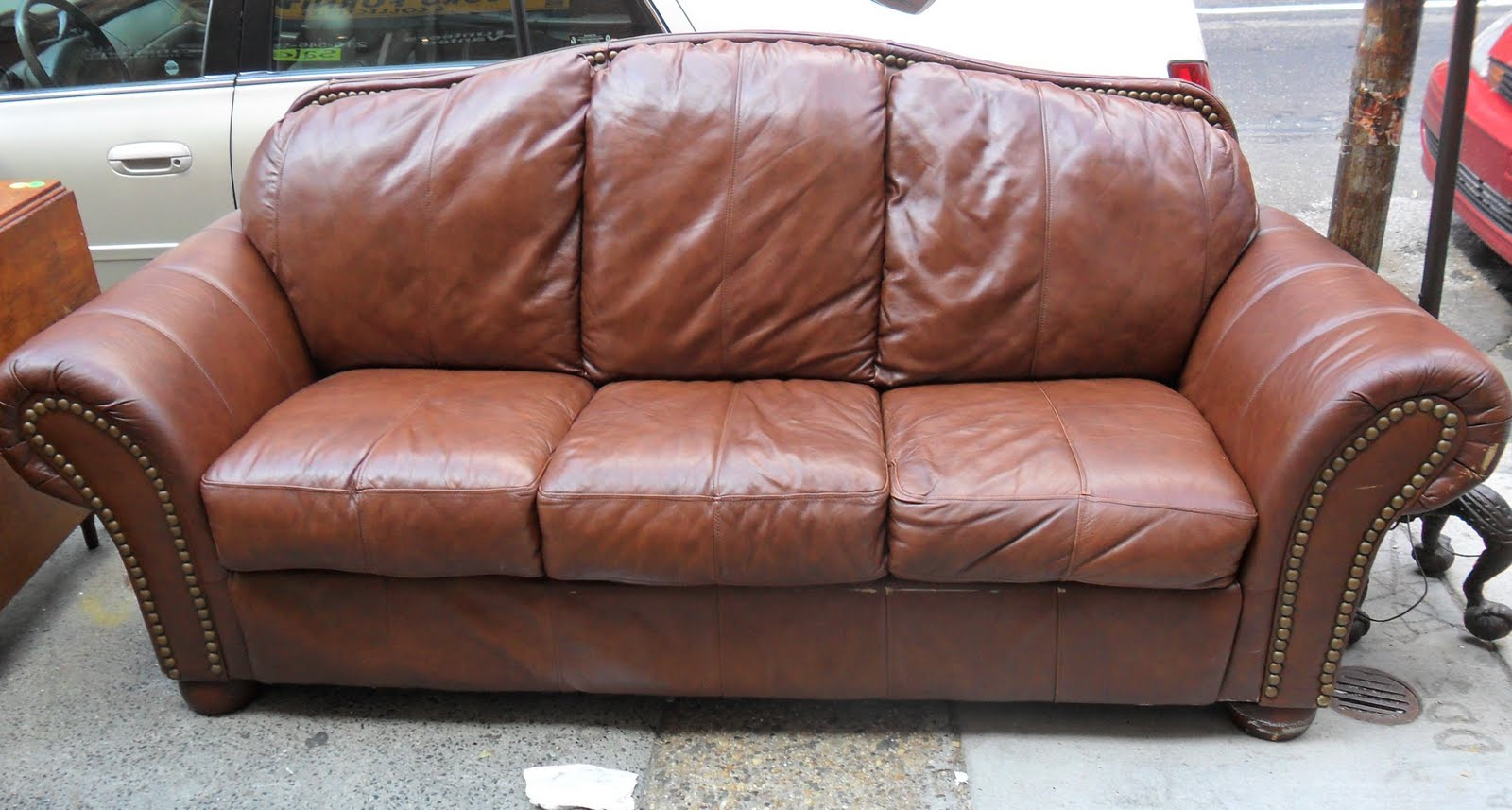 Uhuru furniture collectibles gorgeous leather couch sold for Brown leather couch with studs