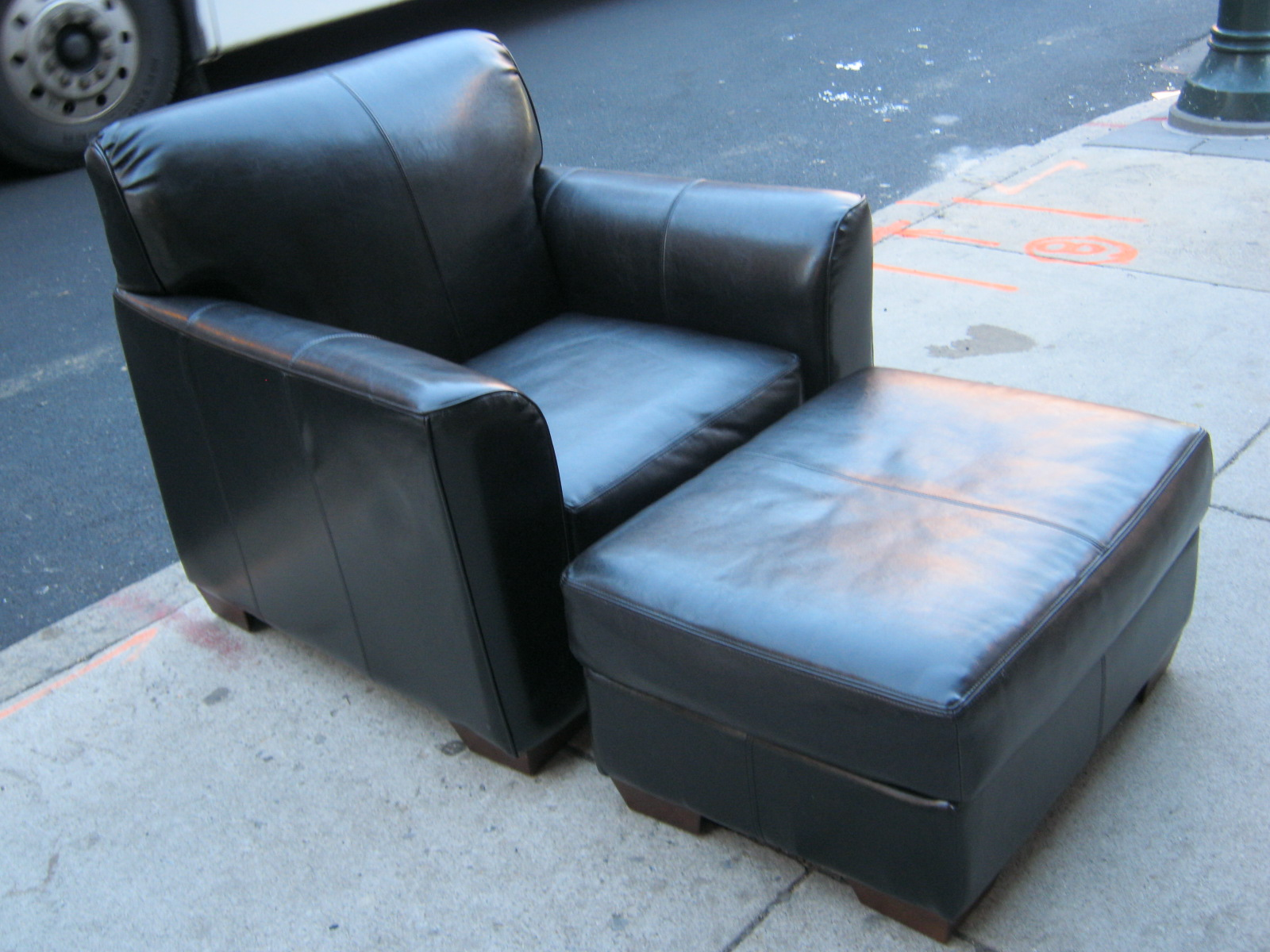 uhuru furniture & collectibles: black leather chair and ottoman sold