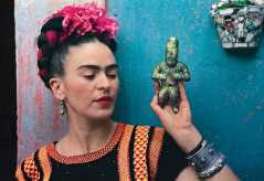 Frida with Olmeca Figurine, Coyoacán; photo Nickolas Muray (1939)