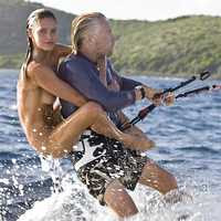 Stephane Gautronneau (photo) - Sir Richard Branson giving Denni Parkinson a piggyback on water skis (2009)