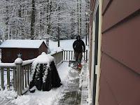 Claire shoveling snow