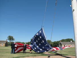 Lewis Takes Down the Flag at Fort Larned