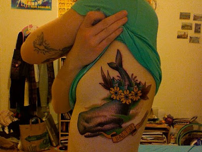 Why? because her whale tattoo looks strangely (if not identical) to one of