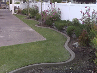 Concrete curbing and landscaping tacoma puyallup for Landscaping rocks tacoma