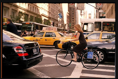 New York cyclist by Bill Cunningham