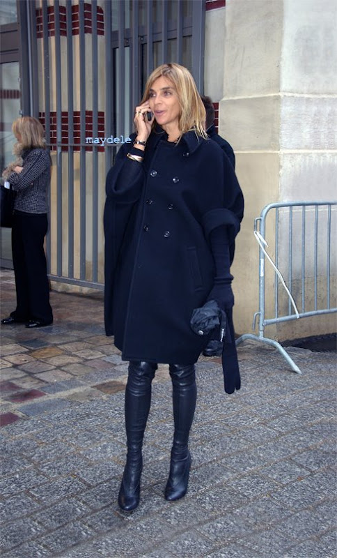 Carine Roitfeld wearing Comme des Garçons coat and Maison Martin Margiela over-the-knee-boots and gloves