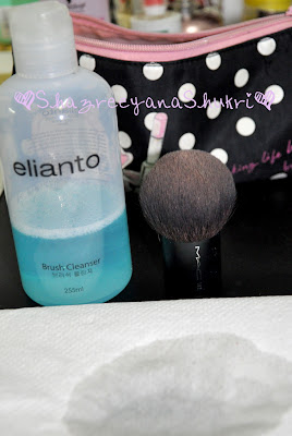 image of elianto brush cleanser and MAC 182 kabuki brush