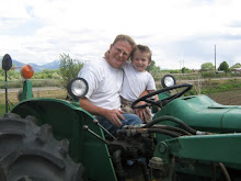 Two of Tyson's favorite things...Papa and tractors!
