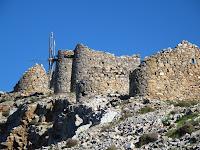 Remnants of windmills arranged on ridge - Lasithiou Plateau