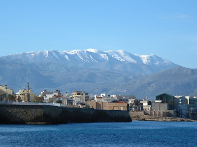 Snowy mountains behind Heraklion - preparation for London?