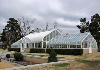 The Greenhouse And Sunken Garden Give The Back Garden A Victorian Look.  Sometimes Orchids Are Displayed Inside.