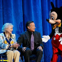 Betty White and Robin Williams share a laugh with Mickey Mouse at the 2009 Disney Legends ceremony at the D23 Expo. Photo courtesy Disney/D23.