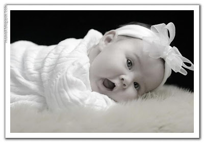 white baby sleeping in the bed