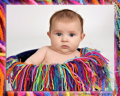 Baby sit in the color thread basket photos