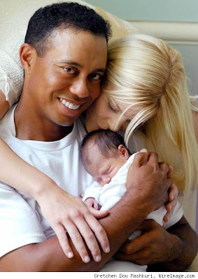 Tiger wood with his baby