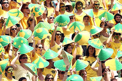 Aussie supporters don hats from the orient.