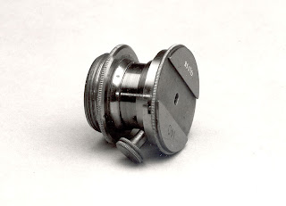 AST0800 Eye-piece for a measuring micrometer head, signed Troughton & Simms, c. 1850 © NMM