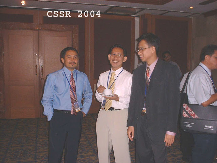 Shahril with (from L to R) Azhar and Rusdin at a conference in Kuching (2004)