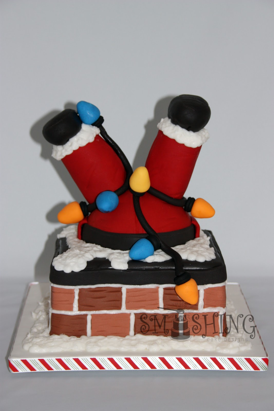 Smashing cake designs december 2010 Santa stuck in chimney cake