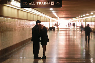 couple saying goodbye sad departure train statino